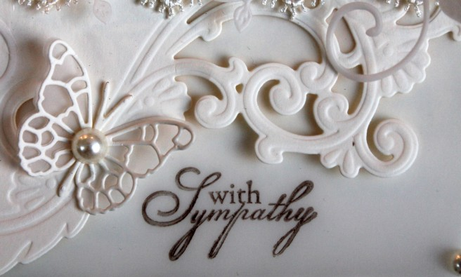 cream sympathy butterly and stamp close up