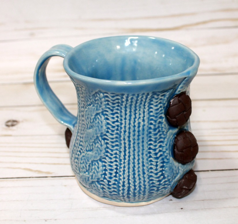 blue sweater mug brown buttons